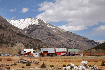 Towering Snow capped Rocky Mountains above the Town of Silverton