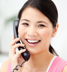 Portrait of a jolly businesswoman talking on phone
