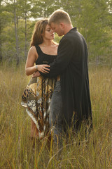 Couple in love on wild grass
