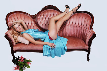 Beautiful girl lying on a sofa.