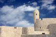 Restored Portugese Fort with watch tower in Bahrain