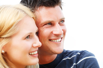 Close-up portrait of a young happy couple. Shallow DoF.