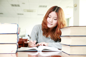 asian girl studying in library