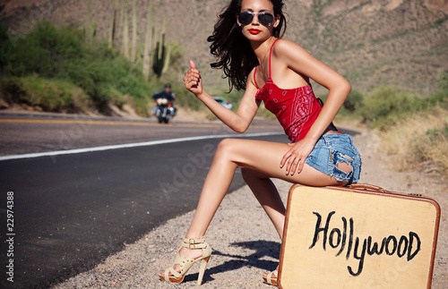 Beautiful woman hitching a ride to Hollywood
