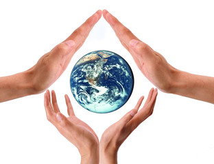 Woman And Man Hands holds Earth Planet