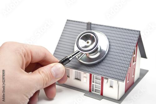 Leinwandbild Motiv Haus mit Stethoskop