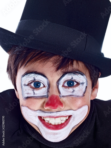 smiling boy with painted face isolated on white background