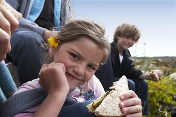 Cute girl eating a sandwich