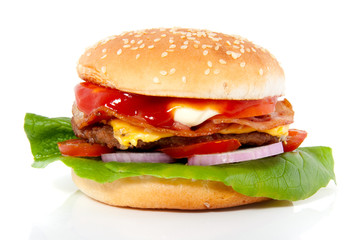 a fresh hamburger with cheese and bacon and salad isolated over
