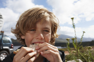 Boy eating a sandwich