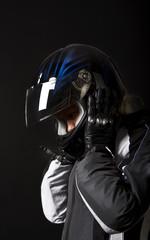 Biker taking off her helmet