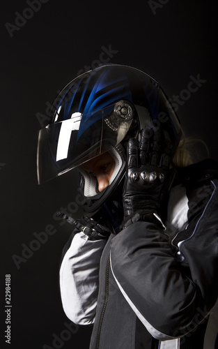 Biker taking off her helmet
