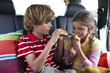 Kids eating a hamburger