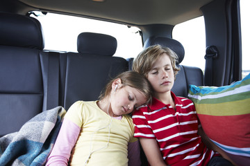 Kids sleeping in the back of a car