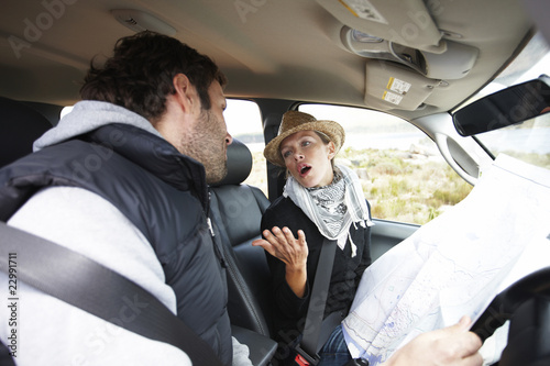 Couple fighting in their car