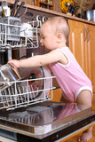 baby at dishwasher in kitchen poster