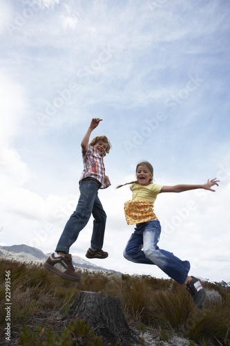 KIds jumping in the countryside