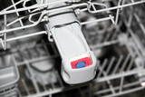Close-up of tablet in dishwasher detergent box poster