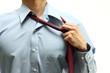Business man untie the necktie
