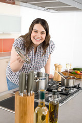 Cook - plus size woman in modern kitchen