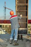 Builder installing formwork poster