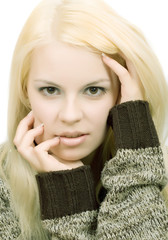 Young blonde woman in sweater