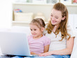 Mother with daughter looking at laptop