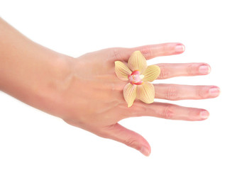 tropical orchid on woman hand