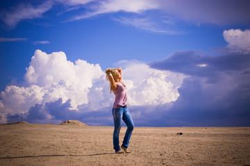 girl blonde on sand