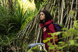 ecotourism: female  hiker exploring wilderness of rainforest poster