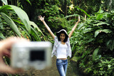 ecotourism:  taking a photo with a digital compact camera poster