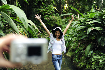 ecotourism:  taking a photo with a digital compact camera