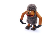Furry wooden monkey toy poster