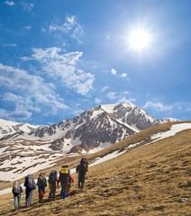 tourist group walking to a mountain pass