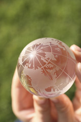 conceptual image of a globe in hands