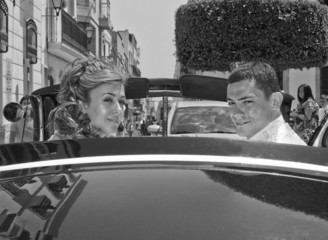 Bride and Groom in wedding car in Black and White