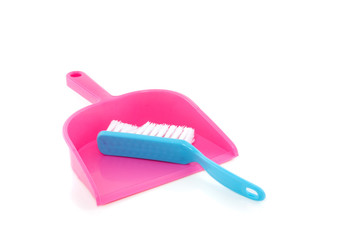 a blue brush and a pink brushpan isolated over white to clean