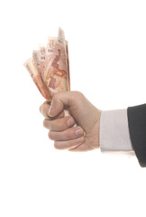 businessman hand with money isolated on white background