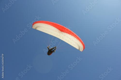 Leinwandbild Motiv Paragliding on the beach