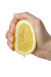 hand squeezing a lemon