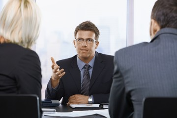 Businessman talking at meeting