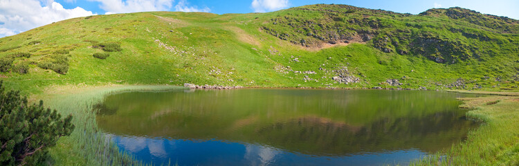 Alpine lake Nesamovyte on summer mountains