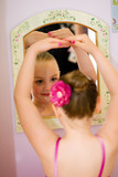 Young Child Looking in the Mirror poster