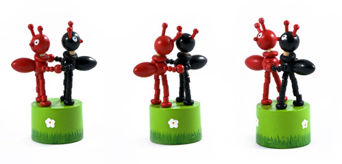 Two toy black and red ant