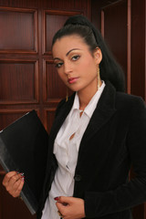 Young businesswoman looking to you