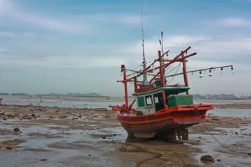 Fishing boat stuck on shore