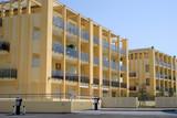 Exterior facade of a modern condominium building poster