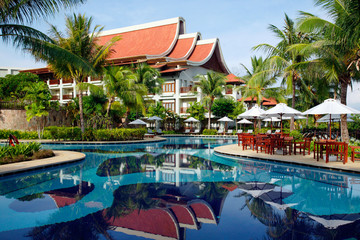 Exotic building and swimming pool in tropical resort.