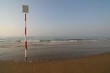 No swimming advice along a seashore poster