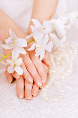 woman's hands, pearl beads and white orchid
